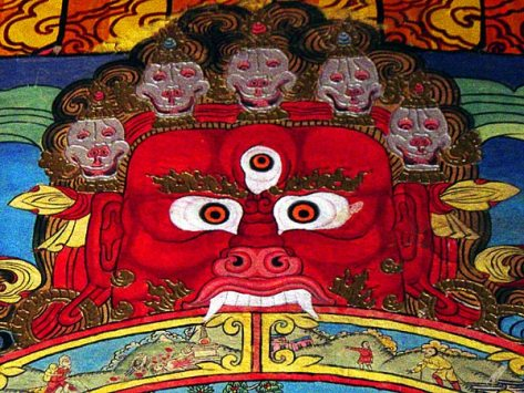 A Tibetan wall painting in Sumtseling monastery depicting Yama, the Lord of Death who holds the wheel of life in his clutches