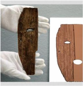 A wooden mask fragment, left, unearthed from the Daifuku archaeological site, is shown in Sakurai, Nara Prefecture. On the right is an artist's rendition of the mask as it would have appeared whole Credit: Toshiyuki Hayashi