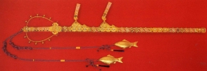 Twin fish decorations attached to a sword