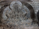 Mani wall carving of Avalokitesvara, Ghap, Nepal (Photo: Manaslu's Mountains of Travel photo gallery)