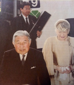 One of Japan's Three Sacred Treasures seen here in a box behind the emperor and empress (courtesy Yomiuri Shimbun)