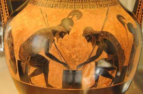 Achilles and Ajax playing a board game. Eight-pointed sun symbols are depicted on their cloaks. Amphora by Exekias, 6th century BC, Vatican Museum Photo: Wikimedia Commons